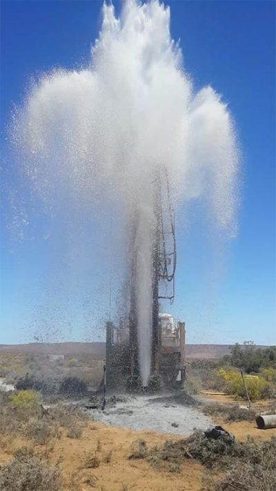 Water shooting into the air from a borehole